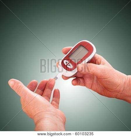 Woman makes measurement Testing high blood sugar.