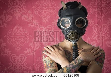 Sexy Woman wearing a Ammo Gas Mask in pink background