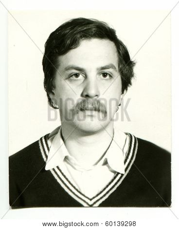 MOSCOW, USSR - CIRCA 1980s: An antique photo shows studio portrait of a  young man