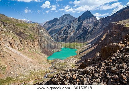 Turquoise lake in mountains of Tien Shan