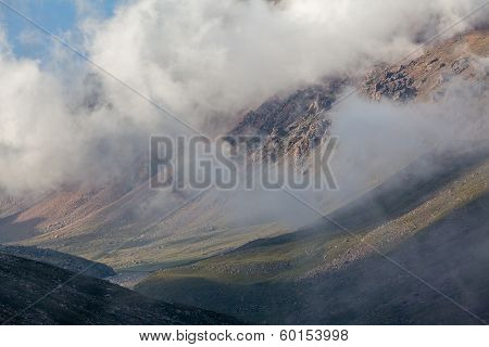 Mountain range in clouds. Kyrgyzstan