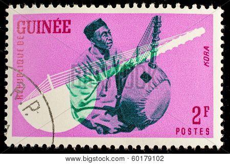 GUINEA CIRCA 1962: stamp printed by Guinea, shows Musical Instrument, Kora, circa 1962