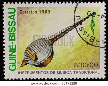 GUINEA - CIRCA 1989: A stamp printed in GUINEA shows Traditional Musical Instruments (kora), circa 1989