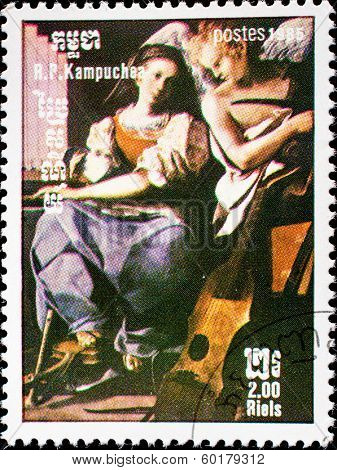 KAMPUCHEA-CIRCA 1985: A stamp printed in the Kampuchea, painting shows St. Cecilia, by Schedoni, circa 1985