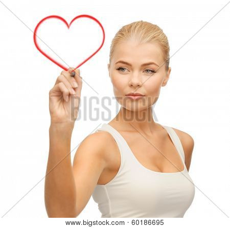 relationaship, love and happiness concept - portrait of woman in white shirt writing in the air