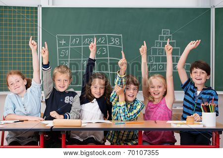 Enthusiastic Group Of Young Kids In Class