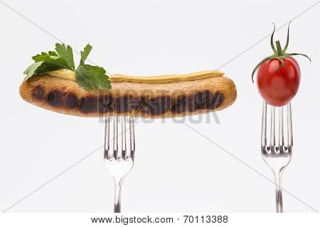 Sausage and tomato with fork