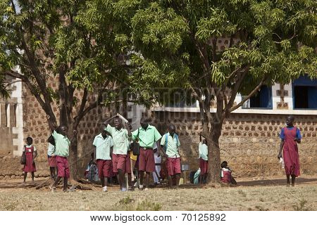 TORIT, SOUTH SUDAN-FEBRUARY 20 2013: Unidentified students leave the primary school in Torit, South Sudan