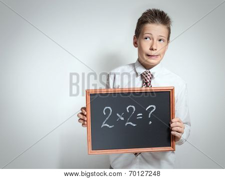 Funny schoolboy has thought of the task decision