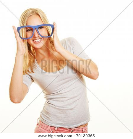 Smiling blond woman with fake nerd glasses on her face