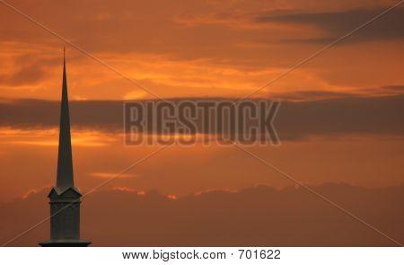 Church Steeple Set Against Sunset