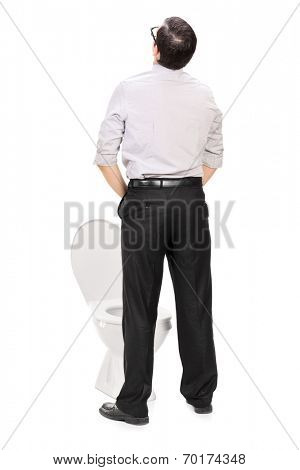Rear view studio shot of a man taking a piss isolated on white background