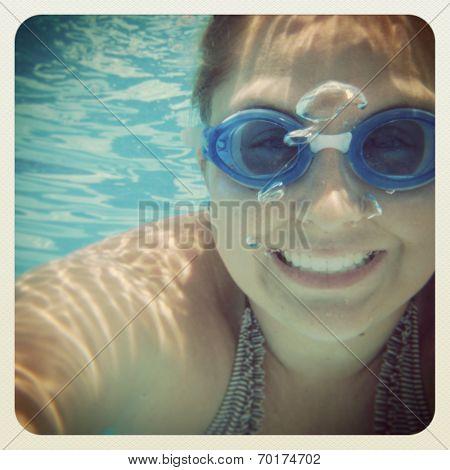 fun instagram of young woman underwater