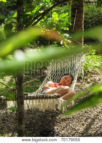 young girl sleeps in hammock