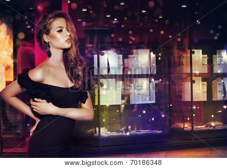 Fantasy. Beautiful Lady Over Shop Window With Jewels