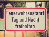 Vintage retro looking A fire lane road sign in German meaning to leave exit free all day and night poster