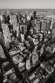 Aerial view of New York cityscape from Manhattan's Midtown East and Upper East Side to Queens in the background. Black & White Vertical New York. Urban view of NY buildings high-rises and skyscrapers seen from above. poster