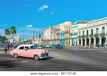 HAVANA, CUBA - JANUARY 8, 2015 : Street scene with people and traffic on a beautiful sunny day in Old Havana