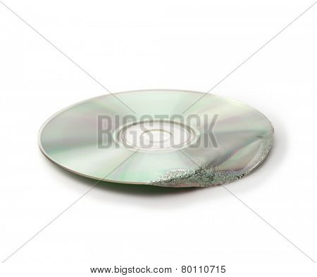 Damaged data. Melted and deformed optical disc (CD, CD-R, DVD, etc ) isolated on white.