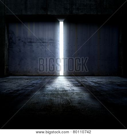 Heavy steel doors opening. Large steel doors of an hanger like building opening and light coming in.