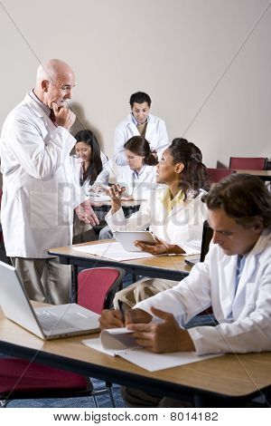 Professor With Medical Students In Classroom
