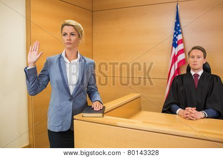 Witness taking an oath in the court room