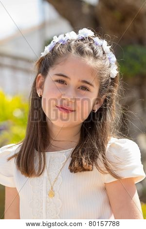 Young Girl Smiling With A Flower