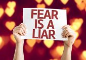 Fear is a Liar card with heart bokeh background poster