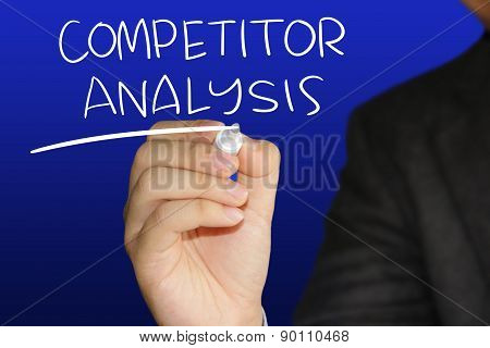 Business concept image of a businessman holding marker and write Competitor Analysis over blue background poster