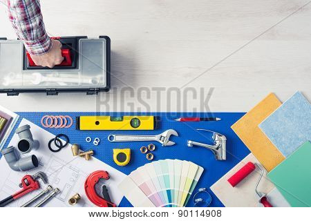 Repairman carrying a toolbox with plumbing tools tiles and color swatches top view home service concept poster