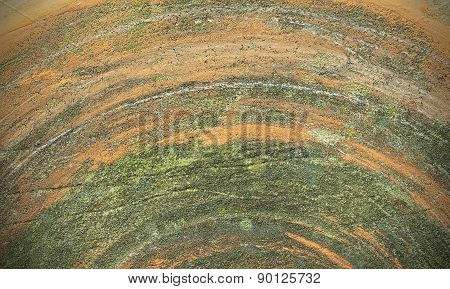 Old Cracked Grindstone Texture Background