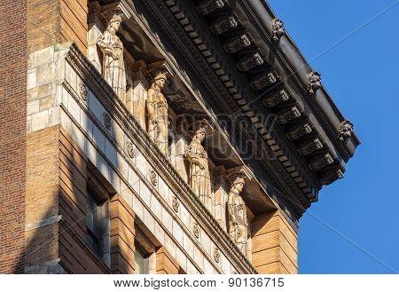 Caryatids And Cornice,19Th Century Brick Building, New York