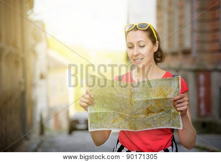 Travel Tourist Woman With  Map.