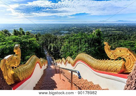 Golden Naka statue on staircase balustrade at Wat Phra That Doi Kham. Temple in Chiang Mai Thailand poster