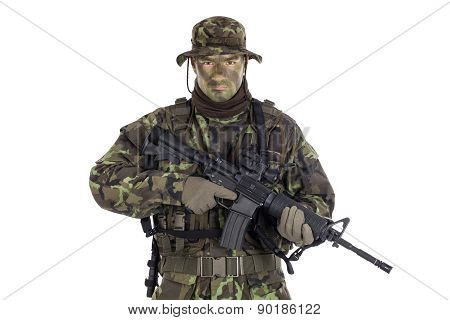 Soldier in camouflage and modern weapon M4. Isolated on white background poster