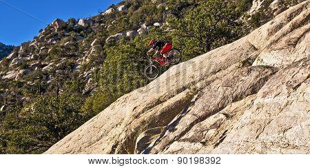 Downhill Bike Rider Rides Down The Mount Lemmon