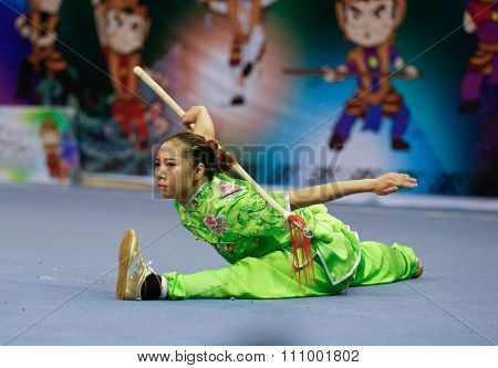 JAKARTA, INDONESIA - NOVEMBER 15, 2015: Xiaoxiao Lai of China performs the movements in the women's Qiangshu (spear) event at the 13th World Wushu Championship 2015 held in Istora Senayan, Jakarta.