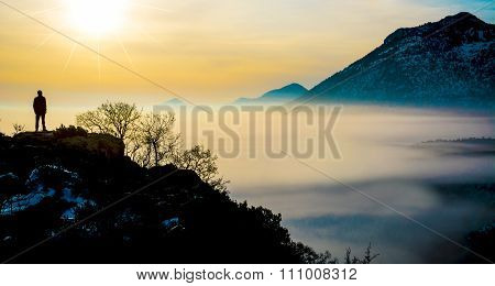 sunrise in the foggy mountains