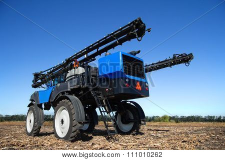 Blue Farm Machine On The Field