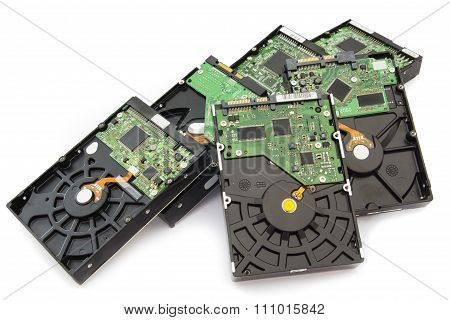 Stack of Old SATA and ATA Hard Disk Drives. Isolated on White Background. poster