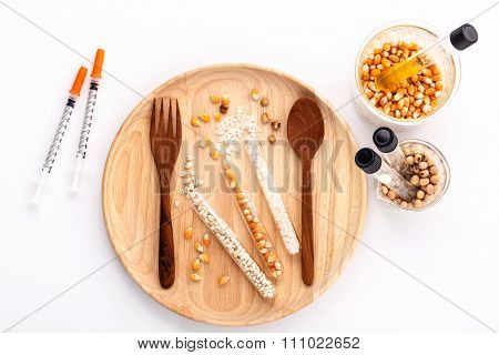 Dangerous Food From  Laboratory Agricultural Grains And Corn With Wooden Fork And Spoon Isolated On