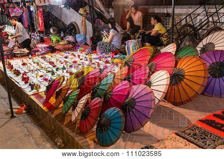Luang Prabang, Laos - Circa August 2015: Souvenirs Are Sold At Night Market In Luang Prabang,  Laos