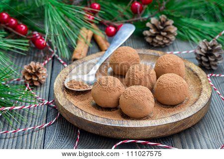 Homemade Chocolate-caramel Truffles On A Wooden Plate