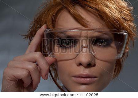 Portrait Of Suspicious Woman In Scientist Glasses
