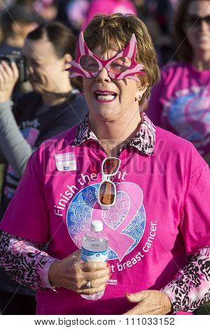 Woman In Outlandish Glasses At Breast Cancer Event
