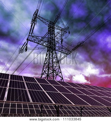 Solar energy panels and electricity pylon against storm clouds.