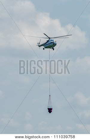 MI-8 helicopter flies for fire extinguishing
