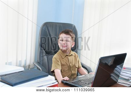 Smiling Boy With The Laptop