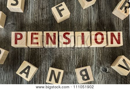 Wooden Blocks with the text: Pension