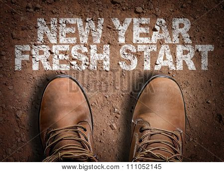 Top View of Boot on the trail with the text: New Year Fresh Start